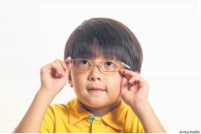 Boy in Yellow with Glasses