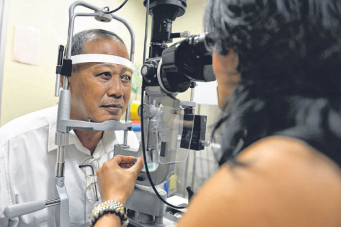 Man having his Eyes Checked