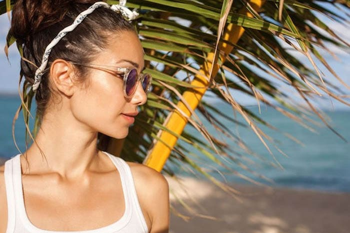 Woman with Sunglasses on the Beach