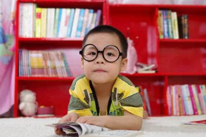 Little Boy in the Library with Eye Glasses